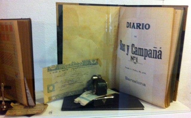 Llibre de comtabilitat de Ros i Campaña, llibre de notes (en alemany) de Josep Arimany (Pepet Menescal), i altres objectes